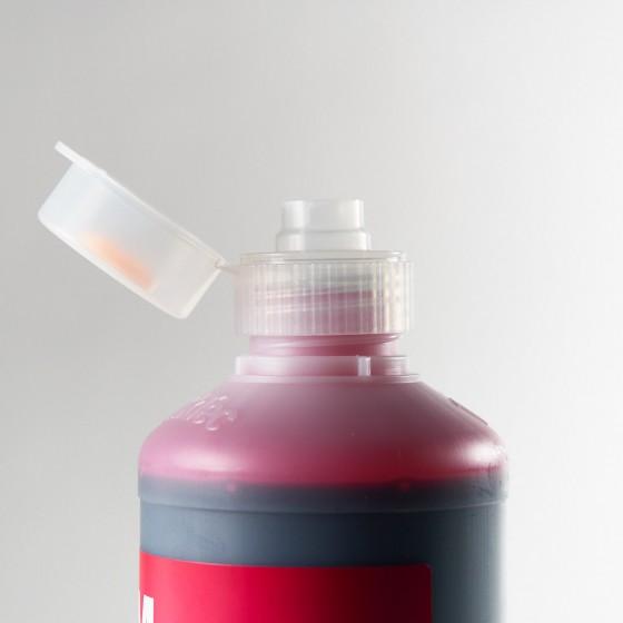 Tapón dosificador para botellas de 1 litrode tinta.